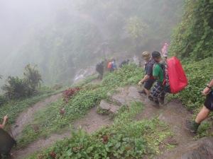 Coming into Alolo Village in the rain