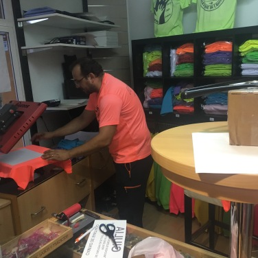 Ionut Prena busily screen printing shirts until all hours!